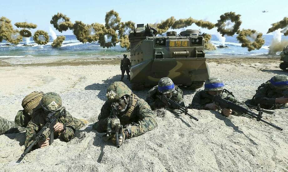 U.S. Marines and South Korean soldiers take part in a beach landing exercise during 2016 military drills. Photo: Kim Jun-bum / Yonhap 2016