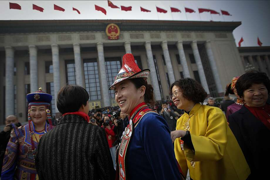 Minority delegates share a light moment as they arrive at the Great Hall of the People to attend the opening session of the Chinese People's Political Consultative Conference (CPPCC) in Beijing, Sunday, March 3, 2019. Thousands of delegates from around China have gathered in Beijing for the annual session of the country's rubber-stamp legislature and its advisory body. (AP Photo/Andy Wong) Photo: Andy Wong / Associated Press