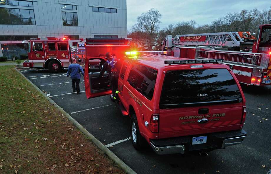 File photo. The Norwalk Fire Department responds to Norwalk High School Tuesday December 5, 2017, after smoke was reported in the science building at the school in Norwalk, Conn. Photo: Erik Trautmann / Hearst Connecticut Media / Norwalk Hour