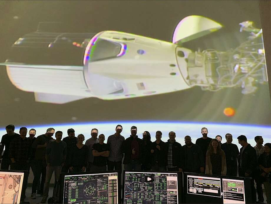 In this photo provided by SpaceX, the SpaceX team in Hawthorne, Calif., watches as the SpaceX Crew Dragon docks with the International Space Station's Harmony module, Sunday, March 3, 2019. SpaceX's new crew capsule arrived at the International Space Station on Sunday, acing its second milestone in just over a day.  (NASA via AP) Photo: Associated Press