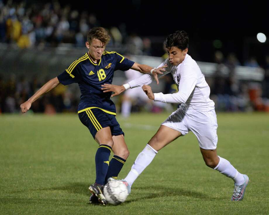Brody Conley (18) of CyRanch and Jovan Prado (10) of Tompkins battle for a ball during the second half of a 6A-III regional quarterfinal soccer playoff between the Tompkins Falcons and the Cy Ranch Mustangs on Friday, April 6, 2018, at Tomball Memorial High School in Tomball. Photo: Craig Moseley, Staff / Houston Chronicle / ©2018 Houston Chronicle