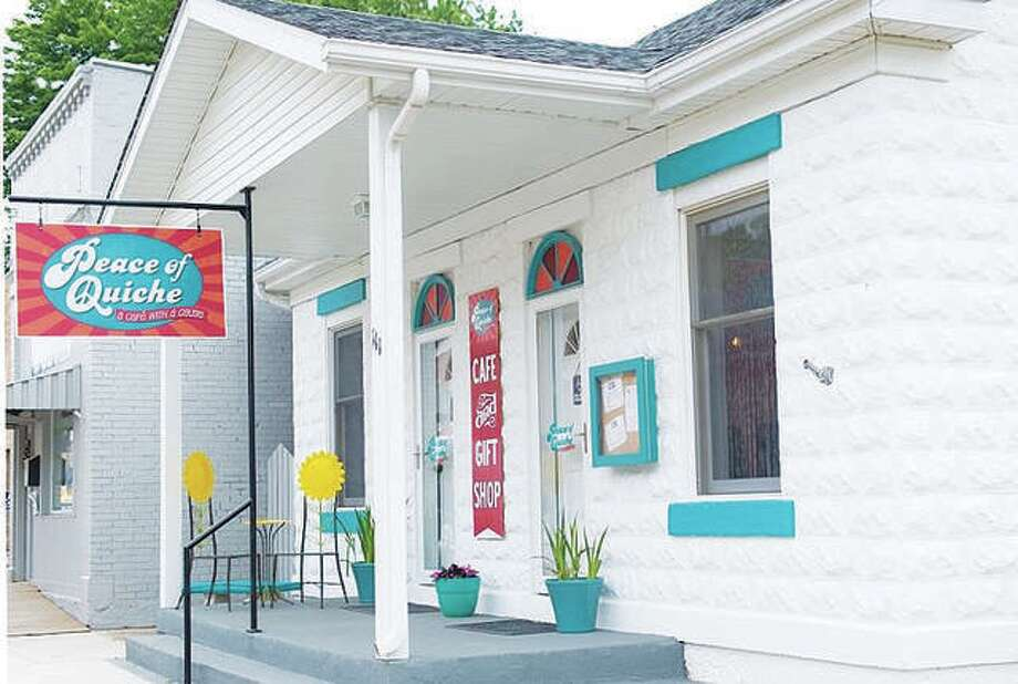 Peace of Quiche owner Julie Connoyer renovated a 1910 building five years ago that was the original Grafton phone company, transforming it into a multicolored café and gift shop with a patio for additional seating and a large deck overlooking the confluence of the Illinois and Mississippi rivers. Photo: For The Telegraph