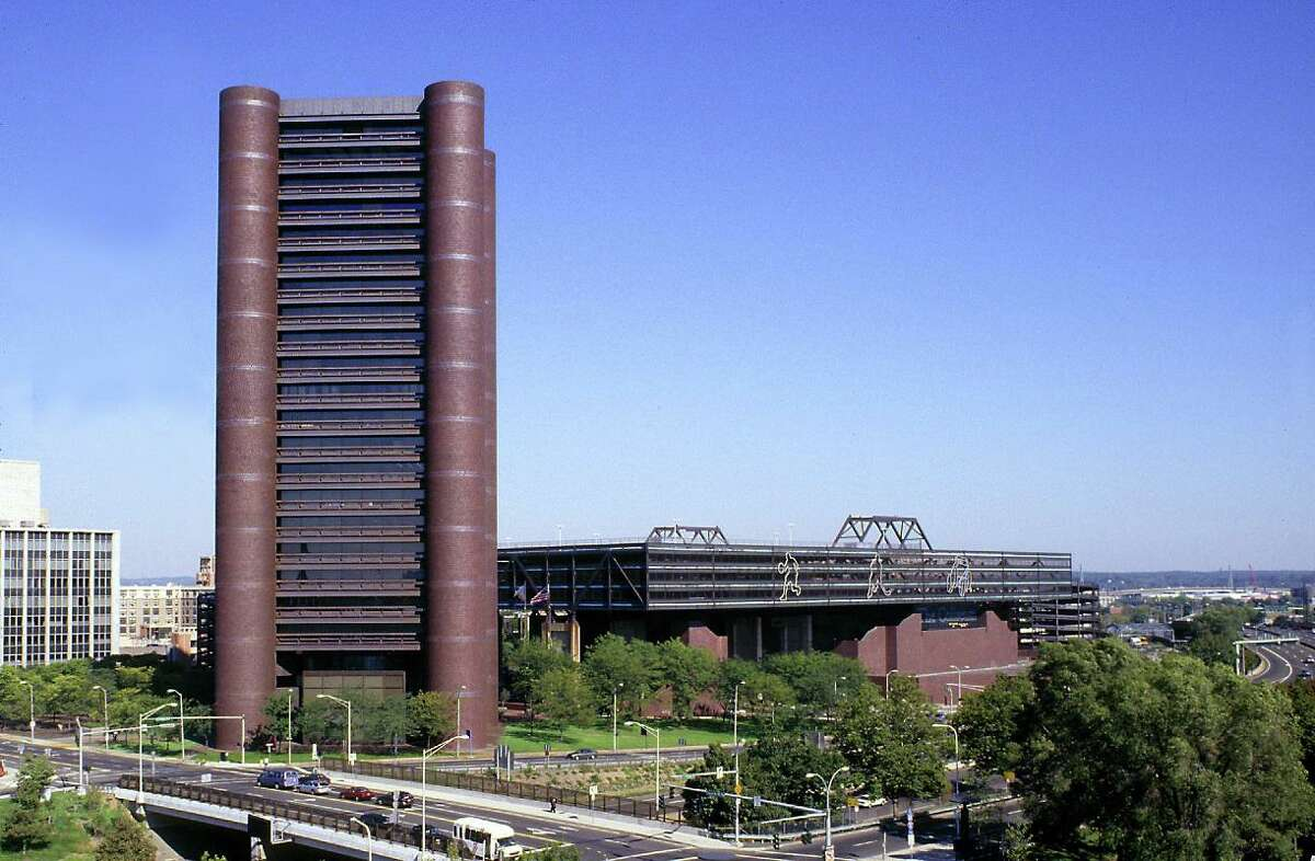 The Knights of Columbus headquarters in New Haven, left, and the now-demolished Veterans Memorial Coliseum to the right. Both buildings were designed by world famous architect Kevin Roche.