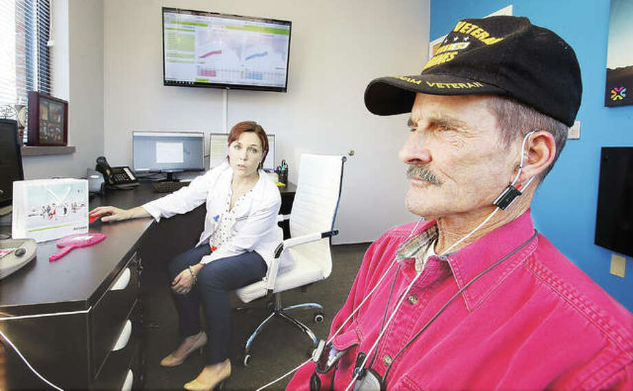 Richard Sparks of East Alton, right, gets fitted recently for a hearing aid at Mid-America Audiology Group by Dr. Chelsea Steer, Au.D. The group recently moved into new offices at 3511 College Ave. in Alton. Photo: John Badman | The Telegraph