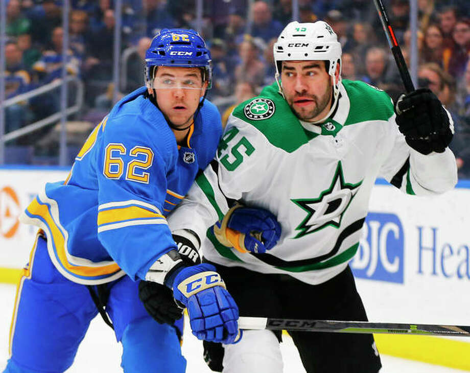 The Blues' Mackenzie MacEachern (62) looks to beat Dallas Stars' Roman Polak to the puck during the second period Saturday night in St. Louis. Photo: Associated Press