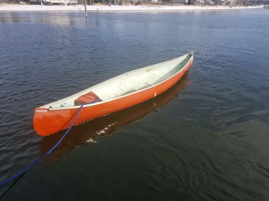 The U.S. Coast Guard is looking for the owner of a red canoe found adrift in Clinton Harbor. Photo: / Contributed Photo /U.S. Coast Guard Of The Long Island Sound Facebook Page