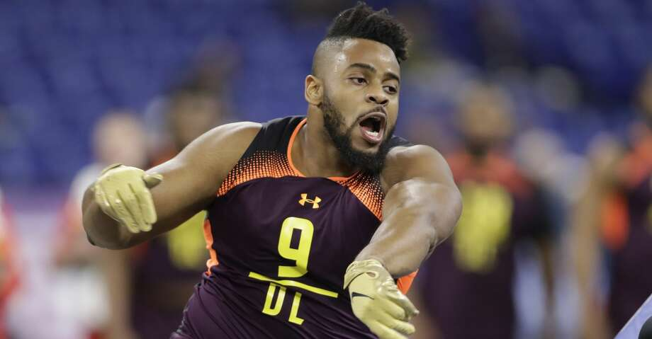 PHOTOS:New Era's official 2019 NFL Draft caps Texas A&M defensive lineman Kingsley Keke runs a drill during the NFL football scouting combine, Sunday, March 3, 2019, in Indianapolis. (AP Photo/Darron Cummings) >>>See the caps that will be worn by players at the 2019 NFL Draft ... Photo: Darron Cummings/Associated Press