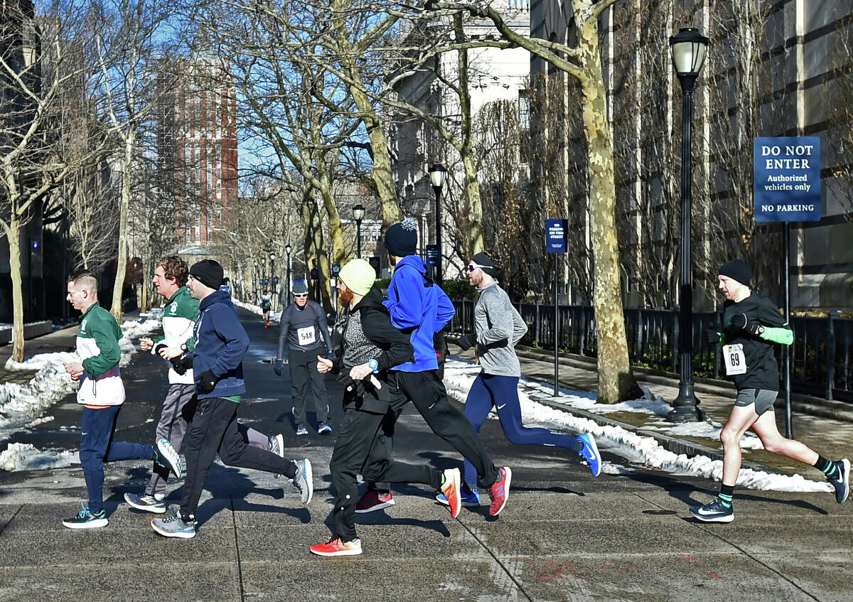New Haven, Connecticut - Sunday, March 3, 2019: The 22nd annual 99.1 PLR Connex Credit Union Shamrock & Roll 5K road race starting on Tower Parkway and finishing at Toad Place in New Haven Sunday to benefit The Diaper Bank. The race is recognized as the USATF-CT 5K State Championship and is one of the largest winter road races held in Connecticut. Toad's Place hosted the annual events after-race party.