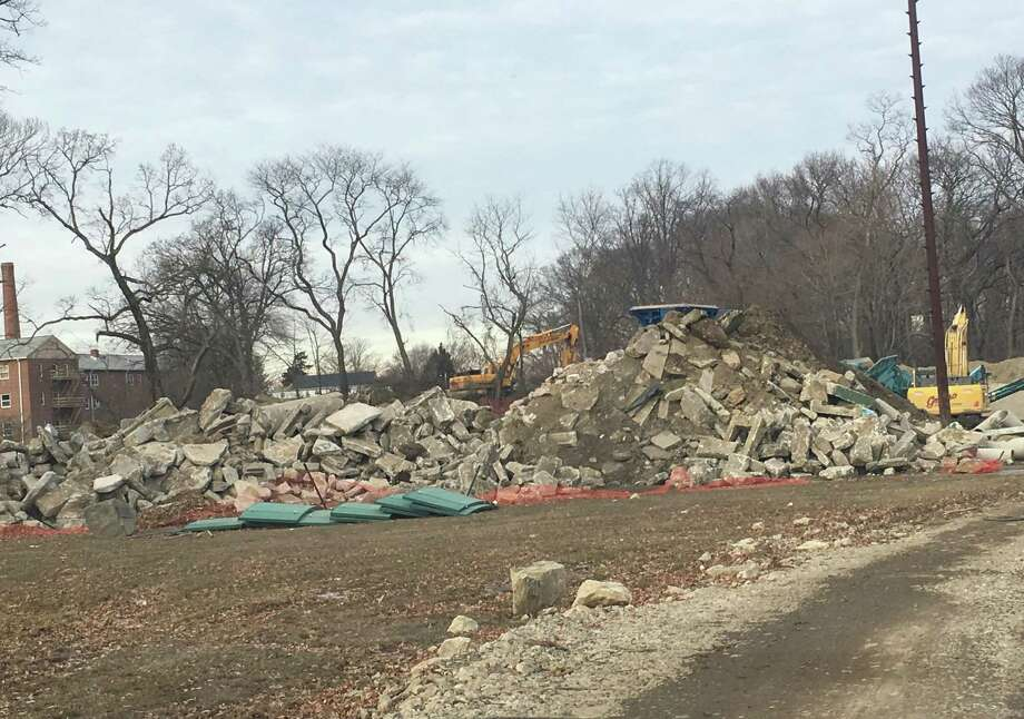 Rock crushing activities, like those that have taken place at Springwood Ely Park tennis courts construction site pictured here, could soon require a permit from the Norwalk Zoning Department. Photo: Contributed /