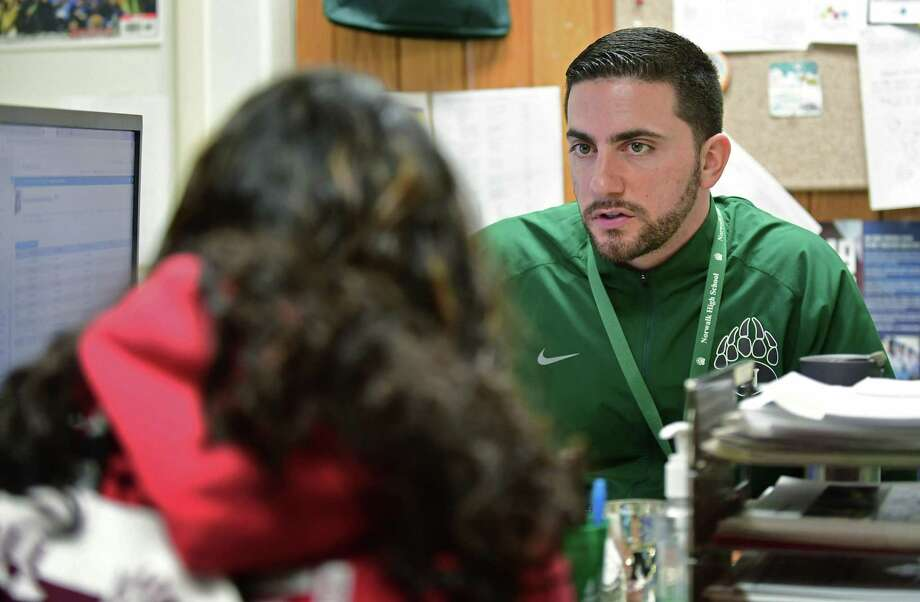 Norwalk High School counselor Mike Surance chats with one of his studnts, Vanesa aksjdk, Friday, March 1, 2019, in Norwalk, Conn. School district leaders are launching an ambitious K-12 study and redesign of school counseling services by examining the responsibilities of such employees, surveying stakeholders regarding their satisfaction with current services, and recommending counselor to student ratios based upon state, national and local requirements. Photo: Erik Trautmann / Hearst Connecticut Media / Norwalk Hour