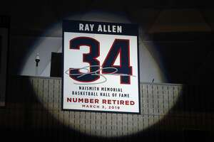 Naismith Memorial Basketball Hall of Famer Ray Allen's number is retired to the rafters during a halftime ceremony in Storrs on Sunday.
