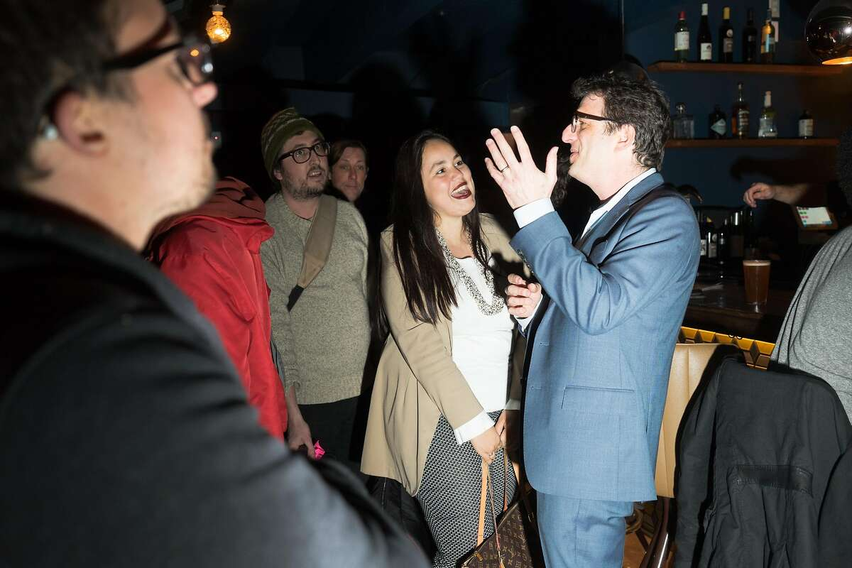 Dean Preston, right, talks with supporters at Phonobar at his campaign launch party in San Francisco, Calif. on Friday, Feb. 22, 2019. Preston is running to be the supervisor of district five.