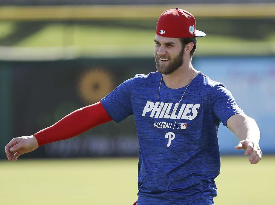 Philadelphia Phillies outfielder Bryce Harper warms up during baseball practice Sunday, March 3, 2019, at Spectrum Field in Clearwater, Fla. (Yong Kim/The Philadelphia Inquirer via AP) Photo: Yong Kim / Associated Press