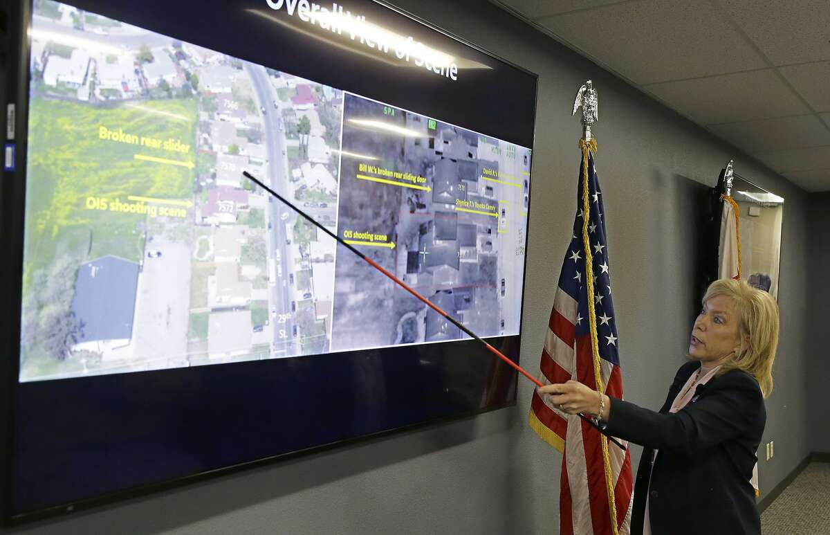 Sacramento County District Attorney Anne Marie Schubert points out the location where Stephon Clark was shot and killed by Sacramento police officers in 2018, during a news conference in Sacramento, Calif., Saturday, March 2, 2019. Schubert said that Officers Terrance Mercadal and Jared Robinet did not break any laws when they shot Stephon Clark after the 22-year-old vandalism suspect ran from them into his grandparents' backyard. (AP Photo/Rich Pedroncelli)
