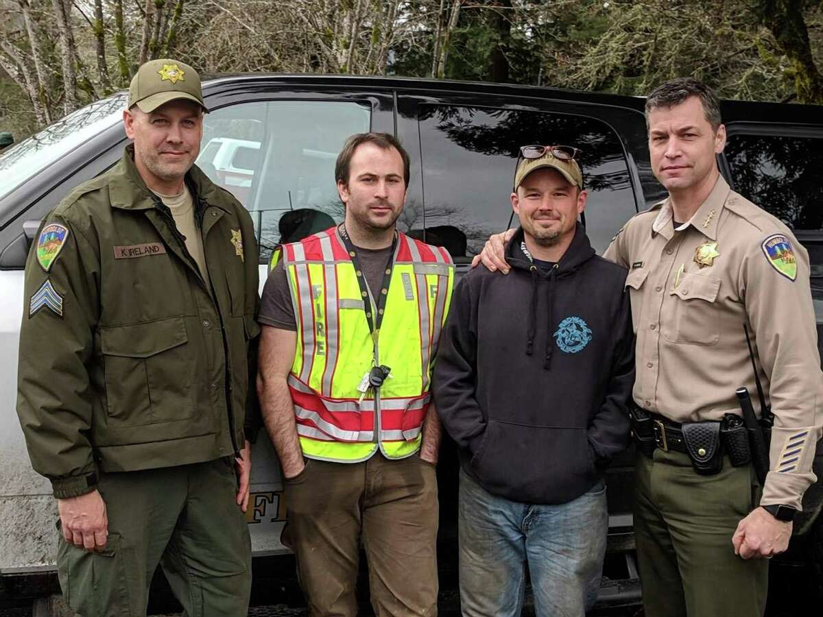 Delbert Chumley (second from left) and Abram Hill (second from right), volunteers from the Piercy Fire Department, pose with Humboldt County Sheriff's deputies after they found missing 5- and 8-year-old girls in a forested area near Richardson Grove State Park. Photo by Humboldt County Sheriff's Office