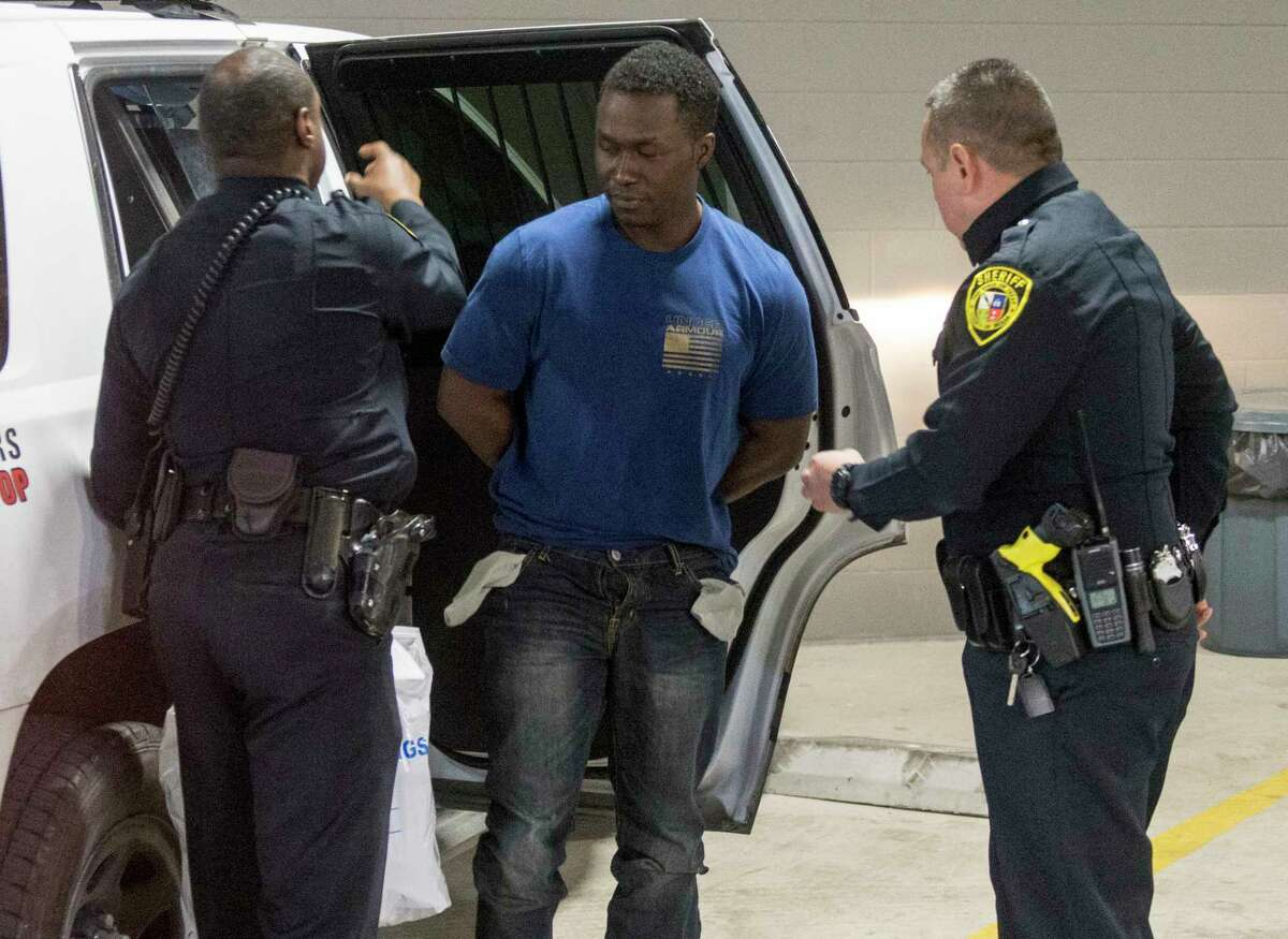 Active-duty US Air Force Major Andre McDonald, center, is escorted Sunday, March 3, 2019 to the Bexar County Magistrate center where where Sheriff Javier Salazar says he will be charged with tampering with evidence in the disappearance of his 29-year-old wife, Andreen Nicole McDonald.