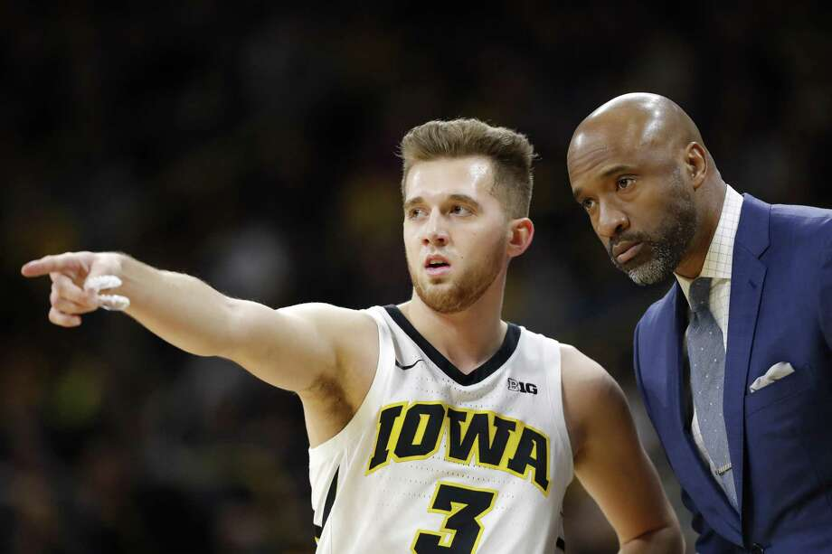 Iowa guard Jordan Bohannon (3) talks with acting head coach Andrew Francis during the first half against Rutgers on Saturday. Photo: Charlie Neibergall / Associated Press / Copyright 2019 The Associated Press. All rights reserved