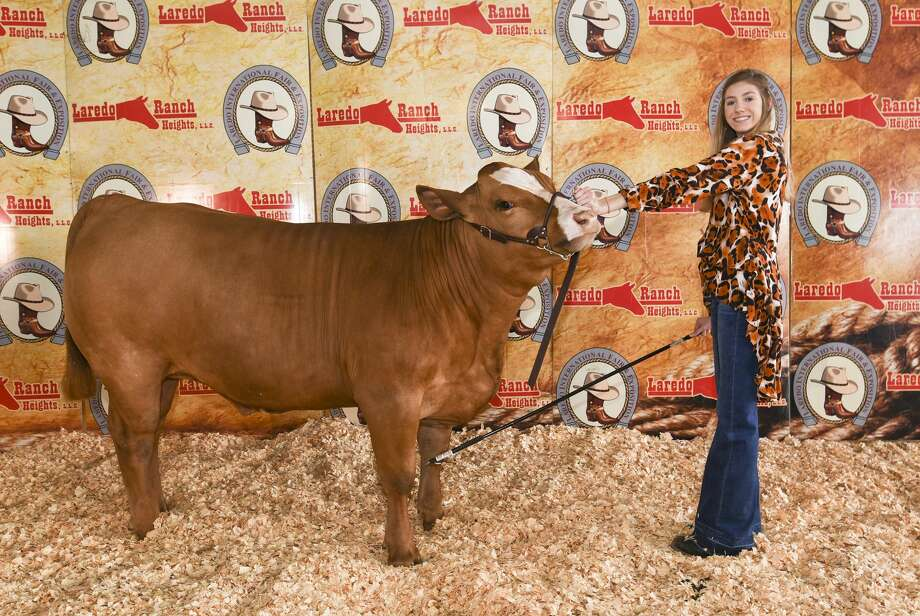 "Victoria Benavides poses for a photo with her reserve grand champion steer ""Apache"" on Saturday, Mar. 2, 2019, during the L.I.F.E. Fair livestock auction at the L.I.F.E. grounds. Photo: Danny Zaragoza/Laredo Morning Times"