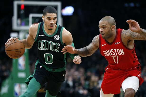 Boston Celtics' Jayson Tatum (0) drives past Houston Rockets' PJ Tucker (17) during the first half of an NBA basketball game in Boston, Sunday, March 3, 2019. (AP Photo/Michael Dwyer)