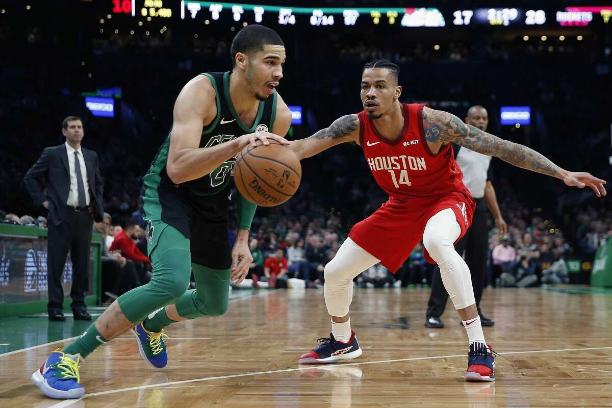 Boston Celtics' Jayson Tatum (0) drives past Houston Rockets' Gerald Green (14) during the first half of an NBA basketball game in Boston, Sunday, March 3, 2019. (AP Photo/Michael Dwyer)