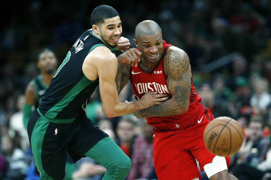 Boston Celtics' Jayson Tatum, left, and Houston Rockets' PJ Tucker battle for a loose ball during the second half of an NBA basketball game in Boston, Sunday, March 3, 2019. (AP Photo/Michael Dwyer) Photo: Michael Dwyer/Associated Press