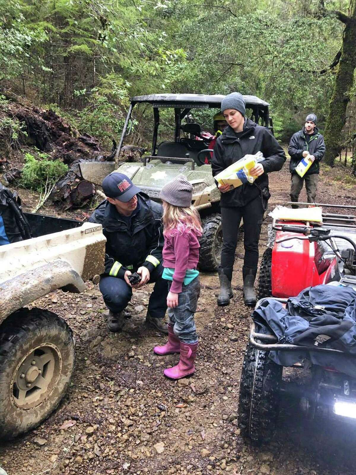 Caroline Carrico is assisted by first responders after she and her sister were found by volunteer firefighters in a park 1.4 miles from their home in Humboldt County. They sisters had been missing for nearly two days. Photo by Humboldt County Sheriff's Office
