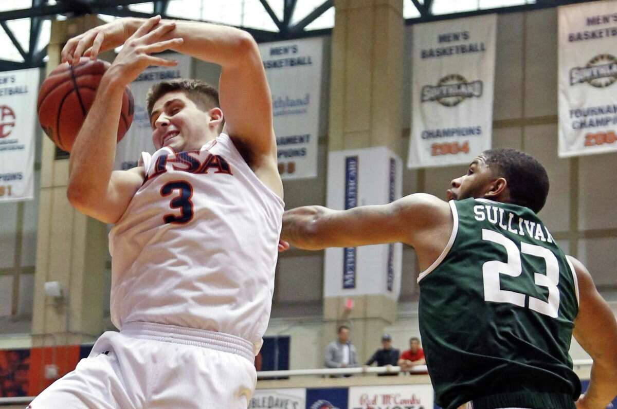 UTSA's Bryon Frohnen is fouled by UAB's Tavin Lovan. UTSA-UAB at the UTSA Convocation Center on Sunday, March 3, 2019.