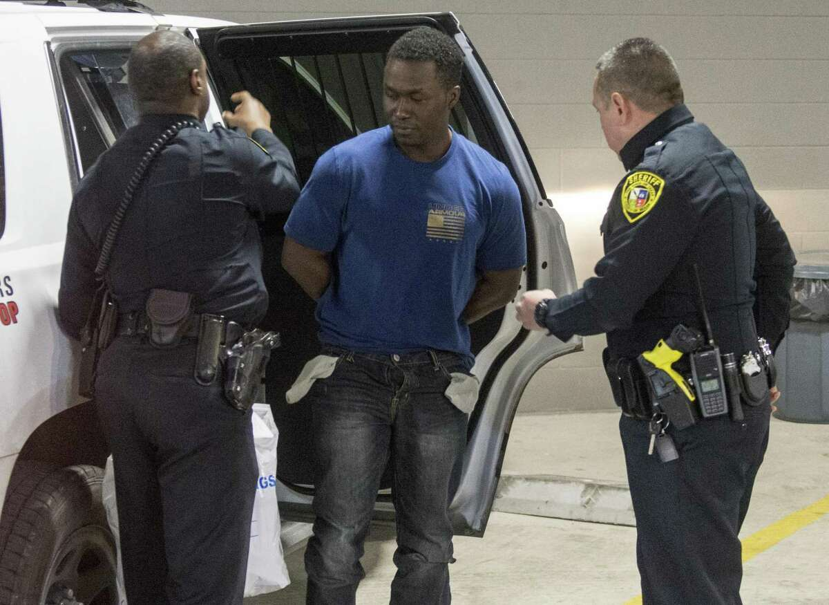 Andre Sean McDonald, 40, is escorted to the Bexar County magistrate center. He has been booked on a charge of tampering with or fabricating evidence tied to the disappearance of his wife, Andreen Nicole McDonald, 29.