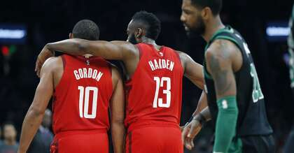 a175c31218e3 Houston Rockets  James Harden (13) talks with teammate Eric Gordon (10) in  front of Boston Celtics  Kyrie Irving (11) during the first half of an NBA  ...