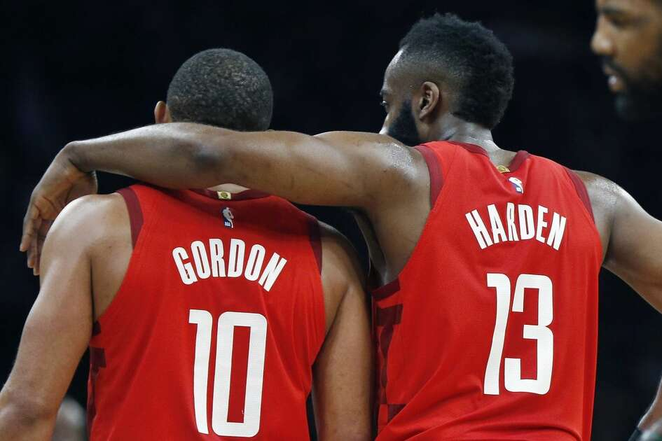 Houston Rockets' James Harden (13) talks with teammate Eric Gordon (10) in front of Boston Celtics' Kyrie Irving (11) during the first half of an NBA basketball game in Boston, Sunday, March 3, 2019. (AP Photo/Michael Dwyer)
