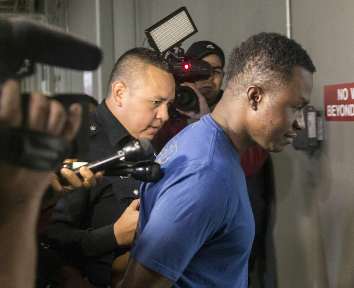Active-duty US Air Force Maj. Andre McDonald, right, is escorted Sunday, March 3, 2019 to the Bexar County Magistrate center where where Sheriff Javier Salazar says he will be charged with tampering with evidence in the disappearance of his 29-year-old wife, Andreen Nicole McDonald.