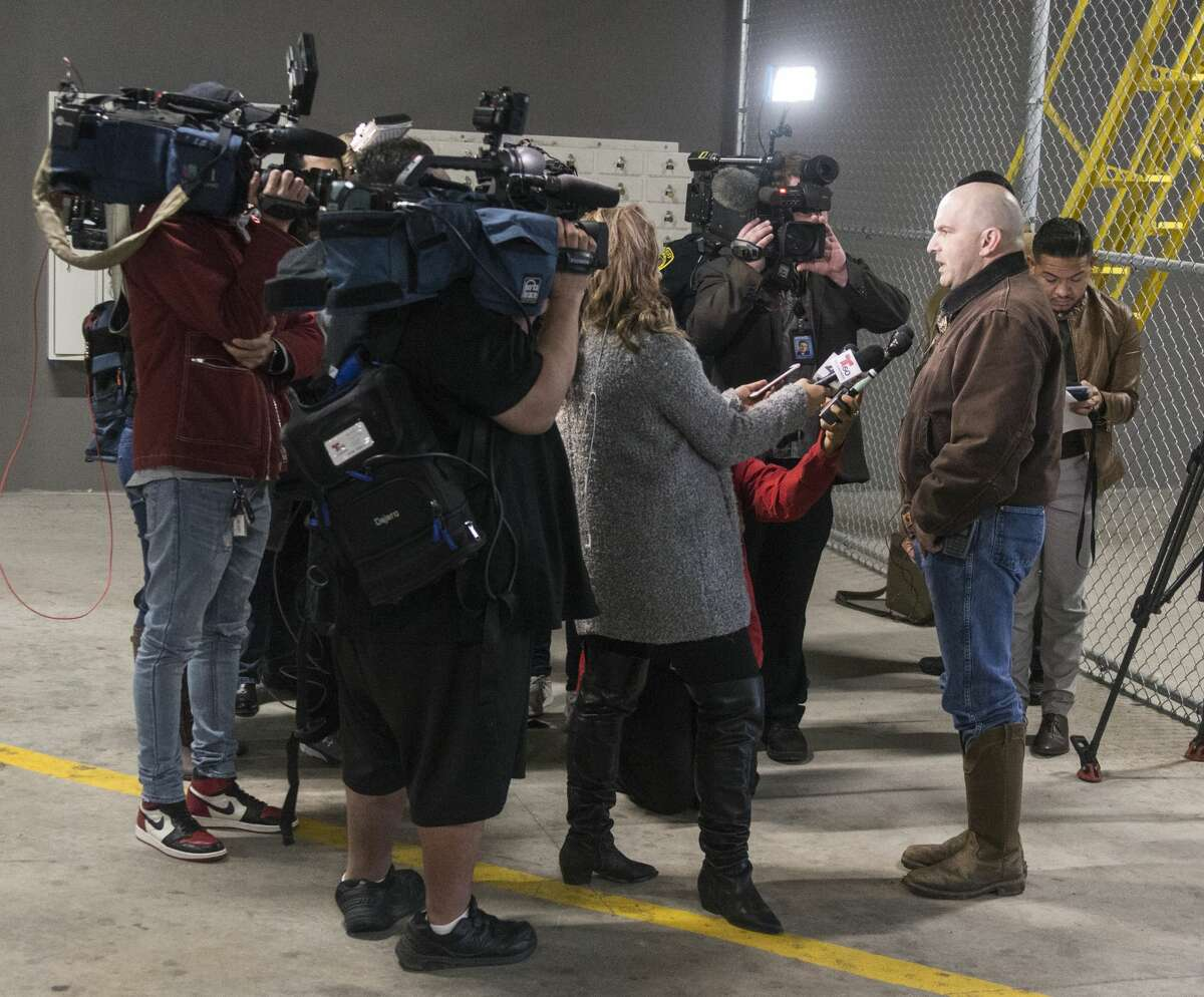 Sheriff Javier Salazar, right, talks to the media Sunday, March 3, 2019 about the arrest of active-duty US Air Force Maj. Andre McDonald. Salazar said McDonald will be charged with tampering with evidence in the disappearance of his 29-year-old wife, Andreen Nicole McDonald.