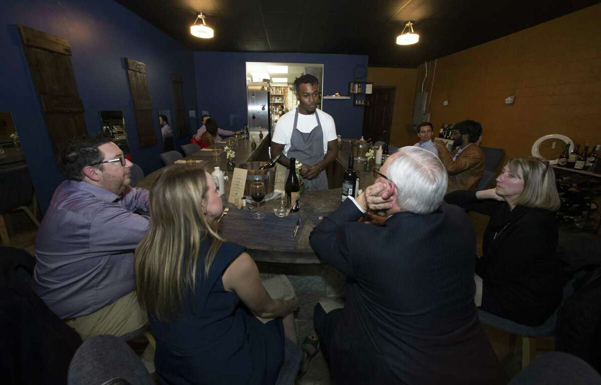 Indigo chef/owner Jonathan Rhodes talks to guests (Jim Barkley, left, and Jennifer and Mark Gribble) during one of the courses at the intimate, neo-soul restaurant in Houston's north side.