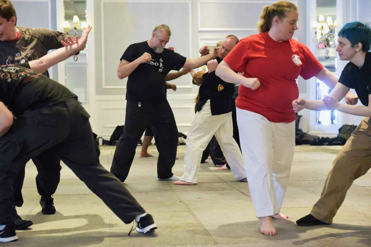 Participants go through slow motion striking exercise as they take part in a class with instructor Mick O'Neill at the Saratoga Martial Arts Festival on Sunday, March 3, 2019, in Saratoga Springs, N.Y. This is the 19th year of the event, which brings together various martial arts instructors from around the country to teach participants. Mark Cardona, director of the festival, said that the two-day event has always been a place where