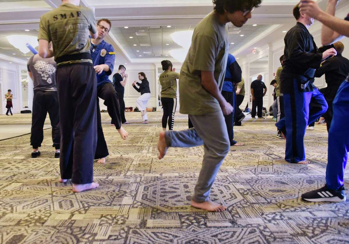 Participants take part in a class with instructor Jeff Burger at the Saratoga Martial Arts Festival on Sunday, March 3, 2019, in Saratoga Springs, N.Y. This is the 19th year of the event, which brings together various martial arts instructors from around the country to teach participants. Mark Cardona, director of the festival, said that the two-day event has always been a place where