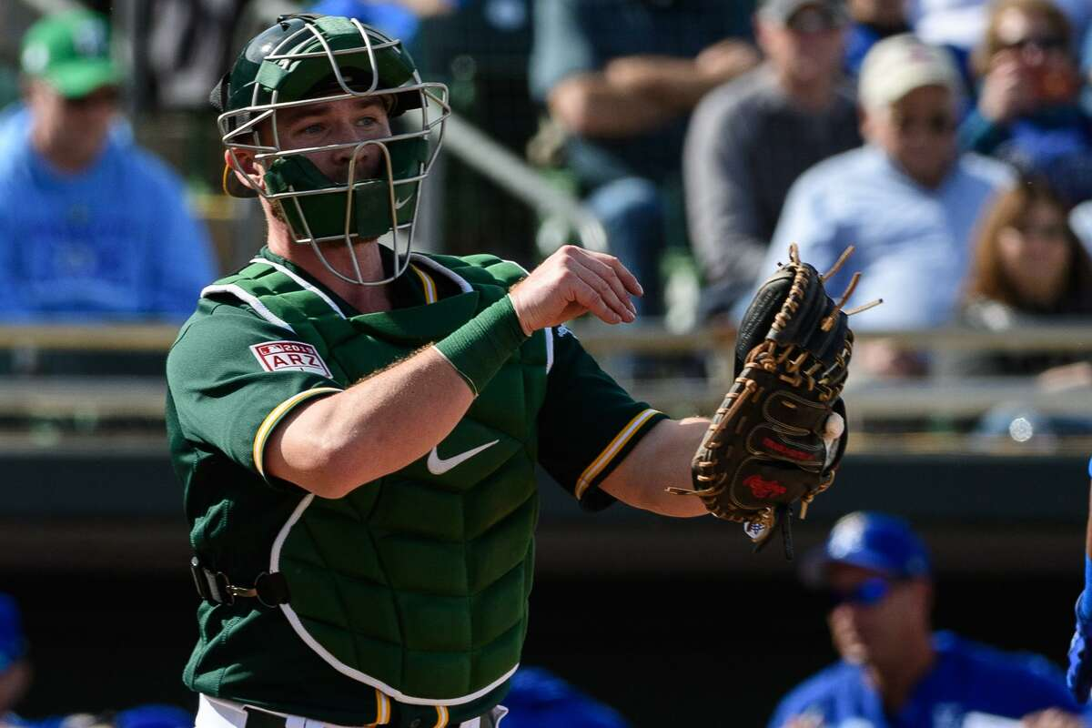 Chris Herrmann #5 of the Oakland Athletics in action during the spring training game against the Kansas City Royals at HoHoKam Stadium on February 24, 2019 in Mesa, Arizona.