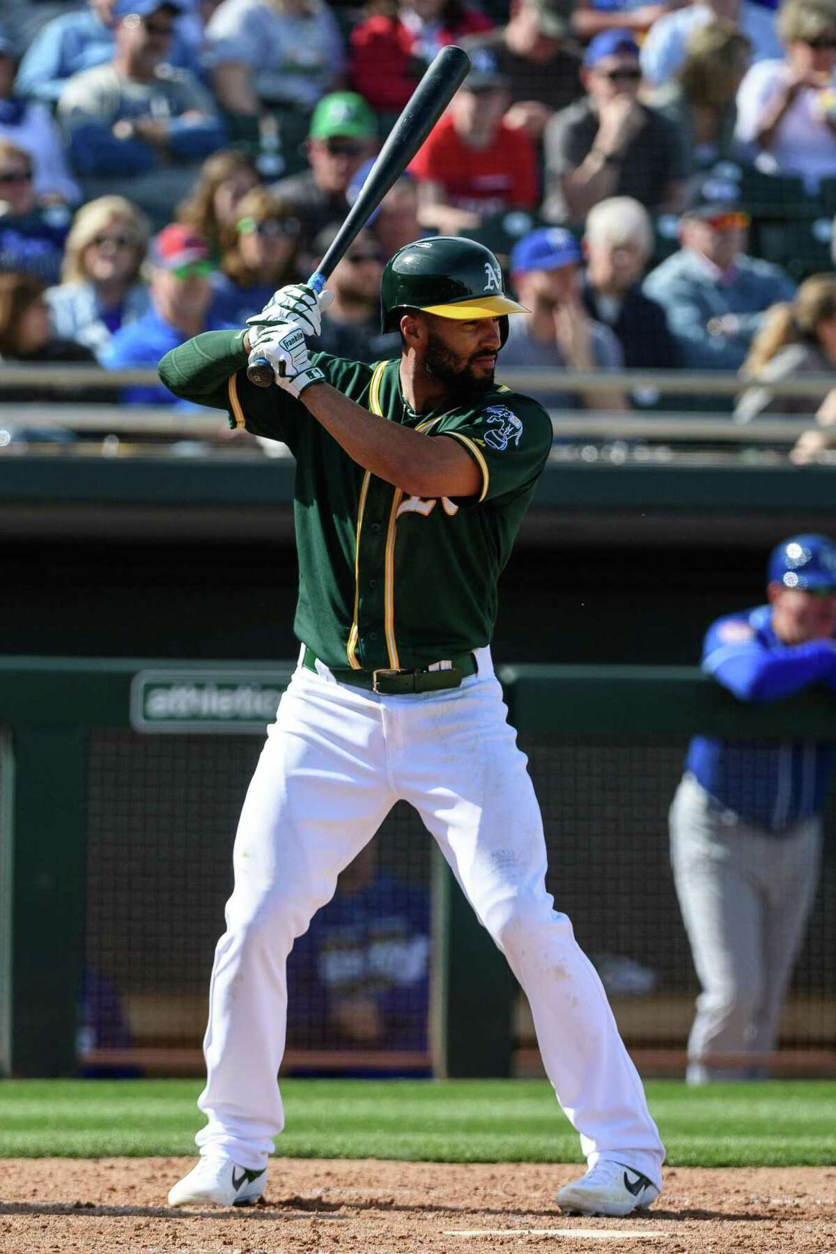 Marcus Semien #10 of the Oakland Athletics stands at bat in the spring training game against the Kansas City Royals at HoHoKam Stadium on February 24, 2019 in Mesa, Arizona.