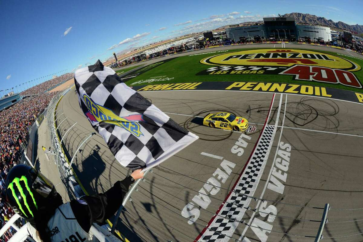 LAS VEGAS, NV - MARCH 03: Joey Logano, driver of the #22 Pennzoil Ford, crosses the finish line to take the checkered flag and win thethe Monster Energy NASCAR Cup Series Pennzoil Oil 400 at Las Vegas Motor Speedway on March 3, 2019 in Las Vegas, Nevada. (Photo by Robert Laberge/Getty Images)