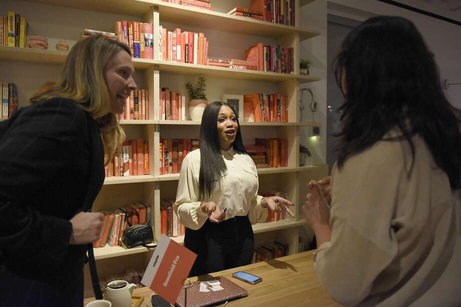 Chanel Melton, 31, founder of the hair extension company RoseGold Pro, speaks with attendees at a Pitch Night hosted at the Wing, a female-only co-working club for entrepreneurs and investors in New York. Photo: Desiree Rios / New York Times