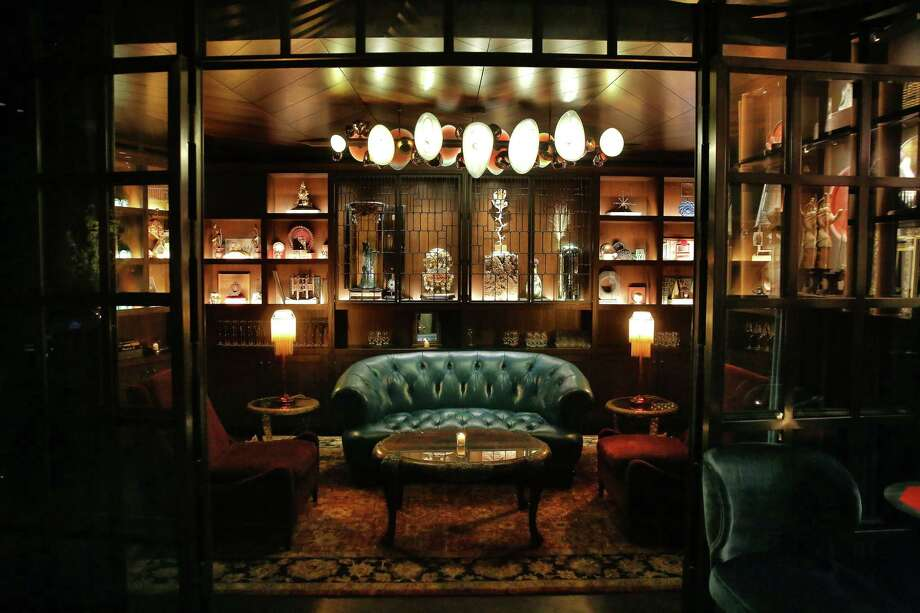 Deep Dive: DowntownBuried below the Amazon Spheres rests Deep Dive, an upscale, posh, vintage-chic hideaway dishing out European bar snacks in typical Renee Erickson fashion and a nod-worthy $18 hot dog over candlelit tables and blue velvet couches. Deep Dive fills up quick, so be sure to make a weekend reservation, and per their clothing code, smart dress is encouraged. Photo: Genna Martin / seattlepi.com