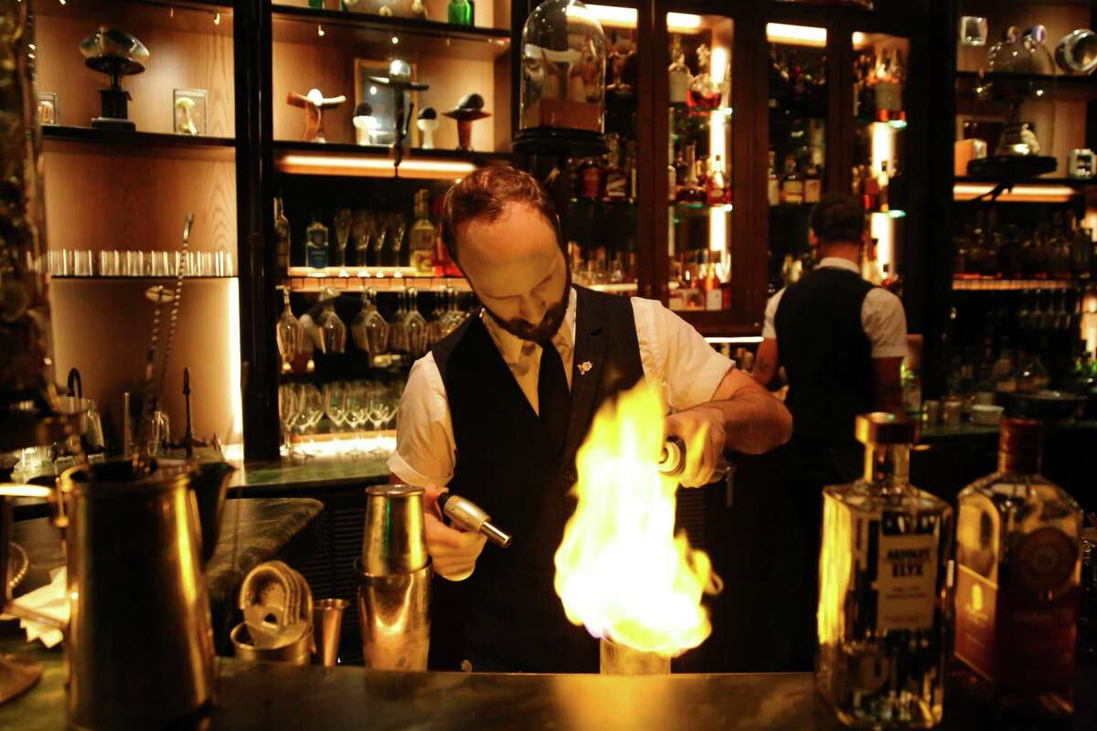 Bartender Jesse Way makes a Rich & Famous at Renee Erickson's new restaurant and bar Deep Dive in the Amazon Spheres.