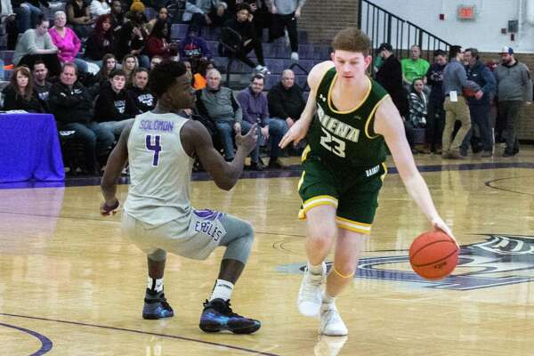 Siena's Sloan Seymour dribbles against Niagara's Raheem Solomon during a basketball game at the Gallagher Center on Sunday, March 3, 2019 in Lewiston, N.Y. (Paul Battson/Special to the Times Union)