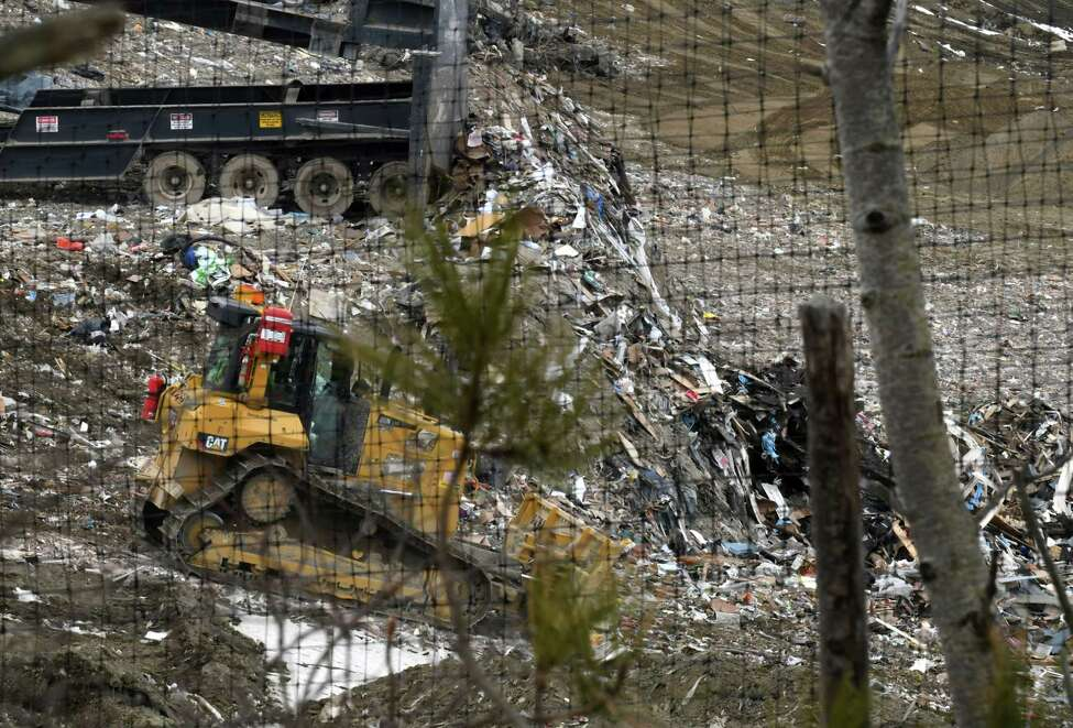 Garbage is dispersed after being dumped at the Dunn C&D Landfill on Wednesday, March 21, 2018, in Rensselaer, N.Y. (Will Waldron/Times Union)