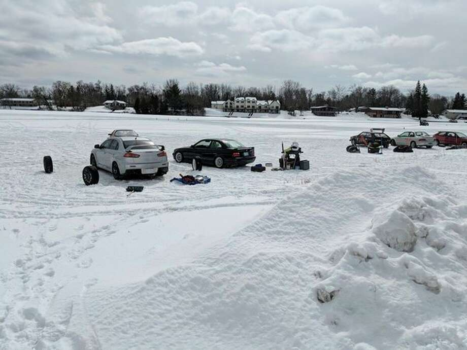 Vehicles and their equipment is lined up and ready to race Sunday on Ross Lake. (Tereasa Nims/For the Daily News)