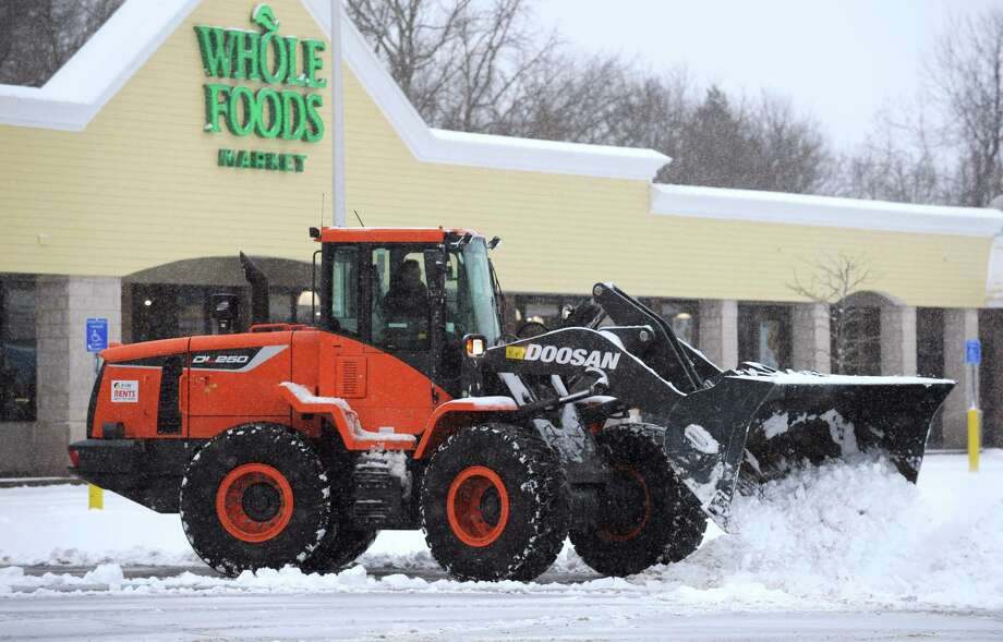 A front loader removes snow for th eparking lot of Whole Foods during the snow storm Saturday March 2, 2019, in Westport, Conn. Photo: Erik Trautmann / Hearst Connecticut Media / Norwalk Hour