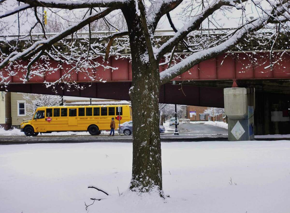 A school bus is driven along Broadway on Monday, March 4, 2019, in Rensselaer, N.Y. Many schools in the Capital Region had a delayed start due to the snow that fell overnight. (Paul Buckowski/Times Union)