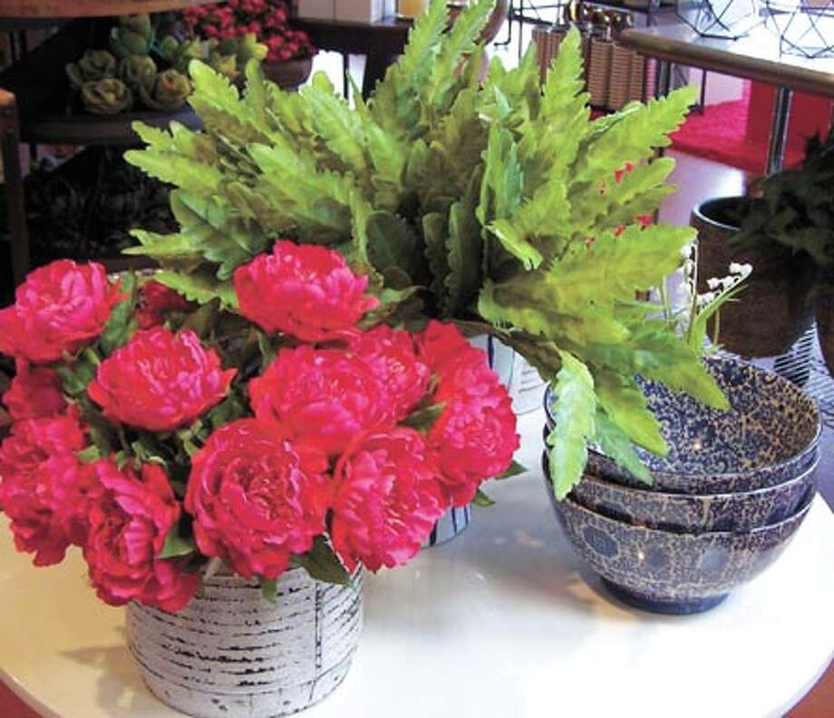 Soon the freshness of the season, like these beautiful peonies, will  burst forth everywhere, These and other amazing arrangements can help  celebrate just about any occasion, including birthdays and  anniversaries. See what exciting colors and collections you can get to  enliven your own home. Flowerland is at 413 Andrews Highway. Photo: Courtesy Photo