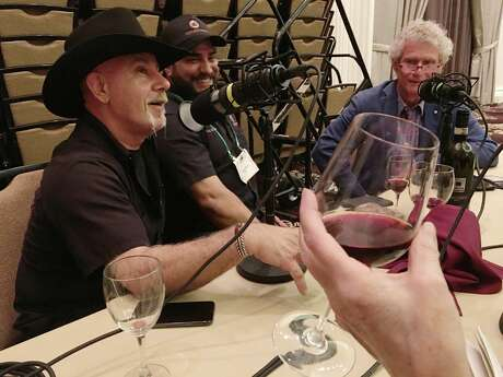 Clockwise from lower left, Ara Malekian, Arash Kharat, Dale Robertson, Alison Cook holding a glass of wine as they record episode of BBQ State of Mind, after a Taste of Italy event at the Hilton Post Oak in Houston, 2/25/19.
