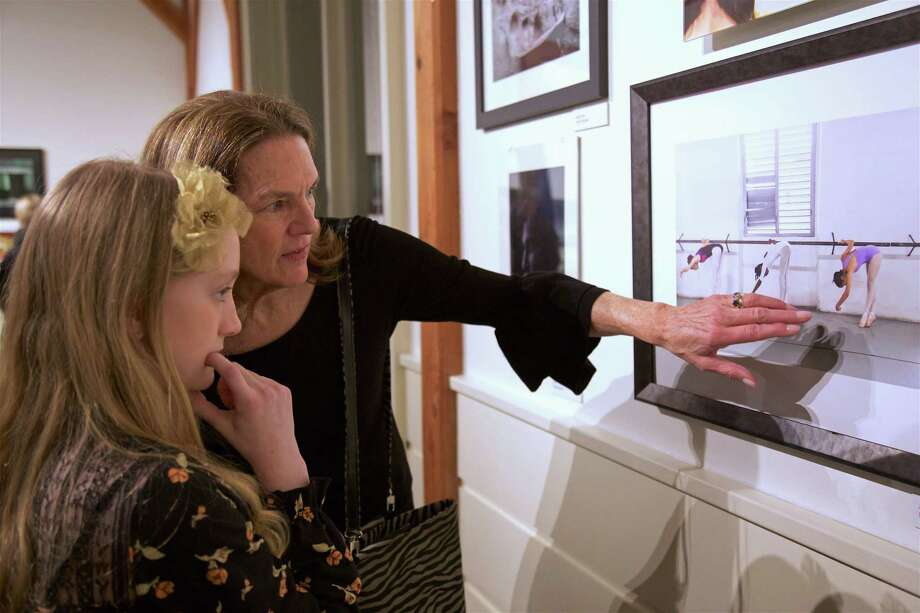 Photographer Nancy Moon of Fairfield and New York City talks about her photo to her newest fan, Aliz Melko, 11, of Fairfield, at the opening reception for the IMAGES 2019 Juried Photography Show at The Fairfield Museum, Thursday, Feb. 28, 2019, in Fairfield, Conn. Photo: Jarret Liotta / For Hearst Connecticut Media / Fairfield Citizen News Freelance