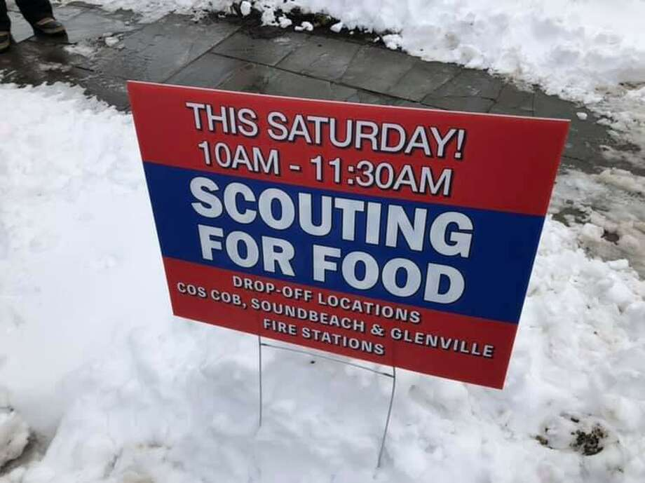 The morning snow on Saturday put a damper on Greenwich Scouting's annual food drive to benefit Neighbor to Neighbor. Scouts were unable to set up outside grocery stores and many collection bags were not left outside homes because of the snow accumulation. Photo: Contributed